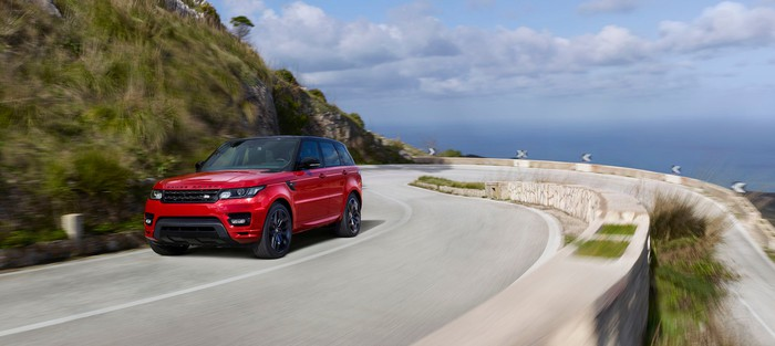Image of JLR's Range Rover Sport driving on a highway.