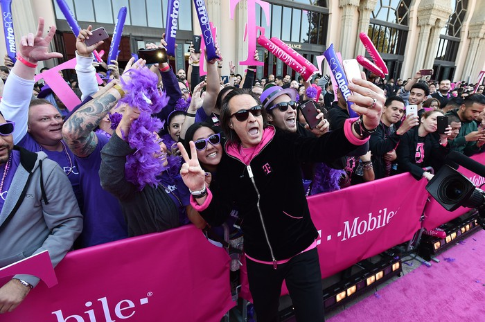 "T-Mobile John Legere greets T-Mobile and Metro PCS employees on the ""Magenta Carpet"" at the Shrine Auditorium in Los Angeles ahead of the Un-carrier X event"