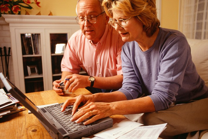 Senior couple using a laptop.