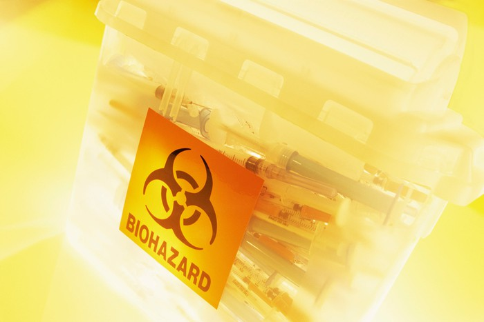 Syringes in a bin for biohazard waste.