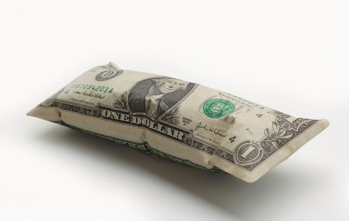 A dollar bill, being inflated like a balloon