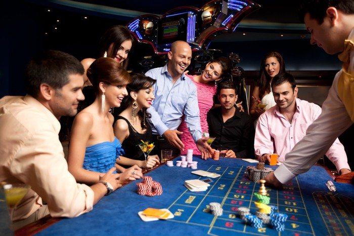 A group of people around a craps table gambling in Las Vegas.