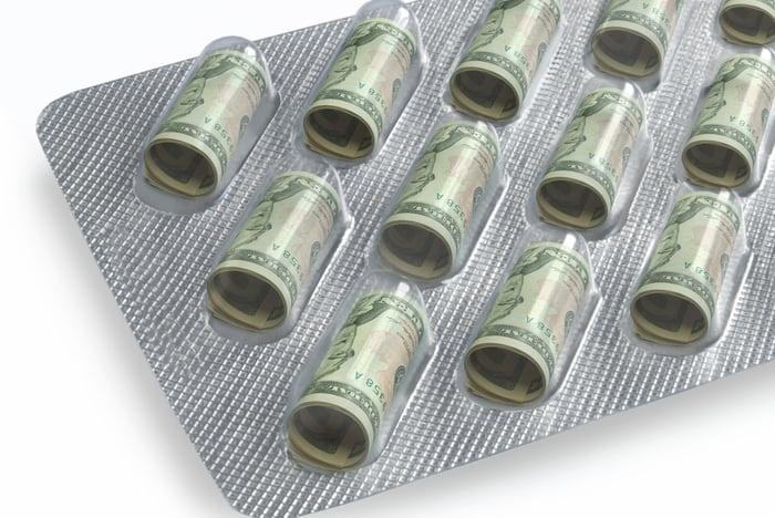 Dollar bills in pill packaging.
