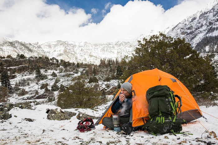 Camping in the mountains during winter with snow on the ground