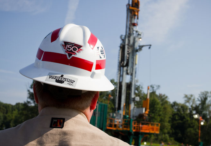 A Consol Energy employee at a well.