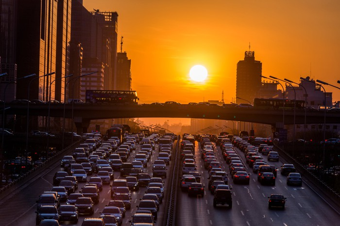 Sunset in Beijing over traffic jam.