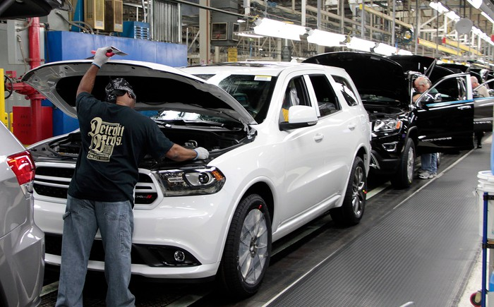 Dodge Durangos and Jeep Grand Cherokees on a factory assembly line.