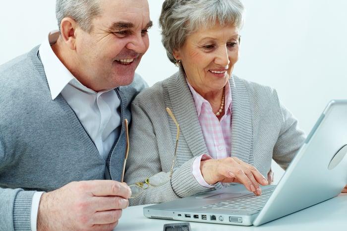 Seniors working at a laptop