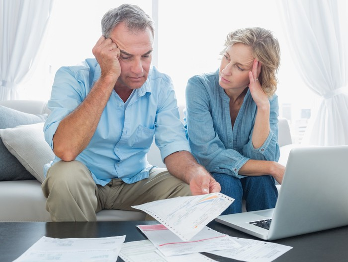 Worried couple looking at finances