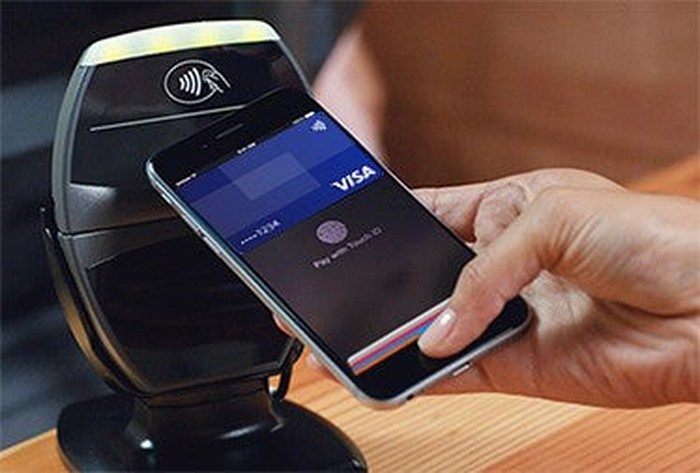 Customer making a purchase with their Visa via a smartphone app