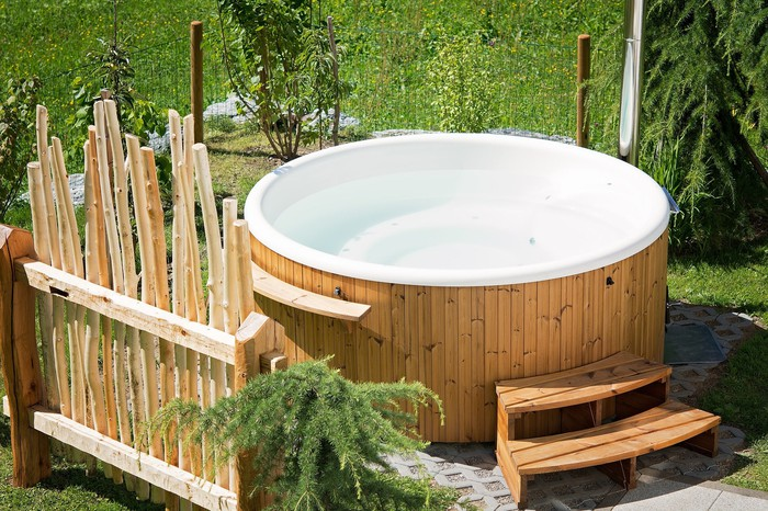 A hot tub is outside.