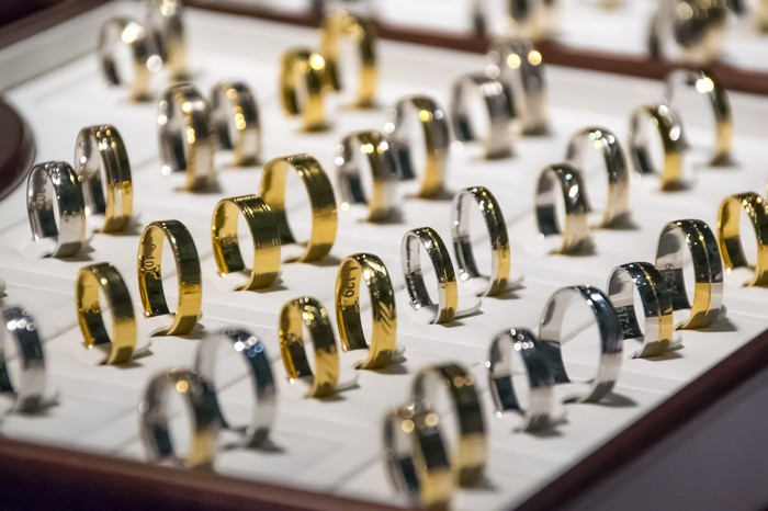 A bunch of silver and gold wedding bands.