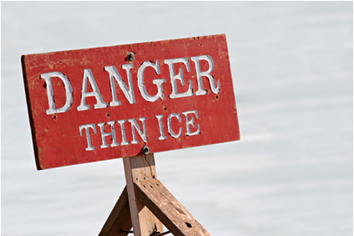 """A sign that reads """"Danger: Thin Ice."""""""