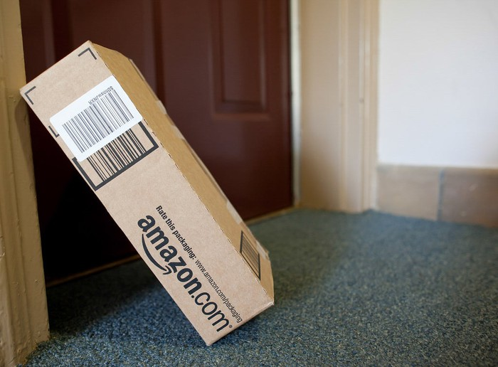 An Amazon package leaning against a door