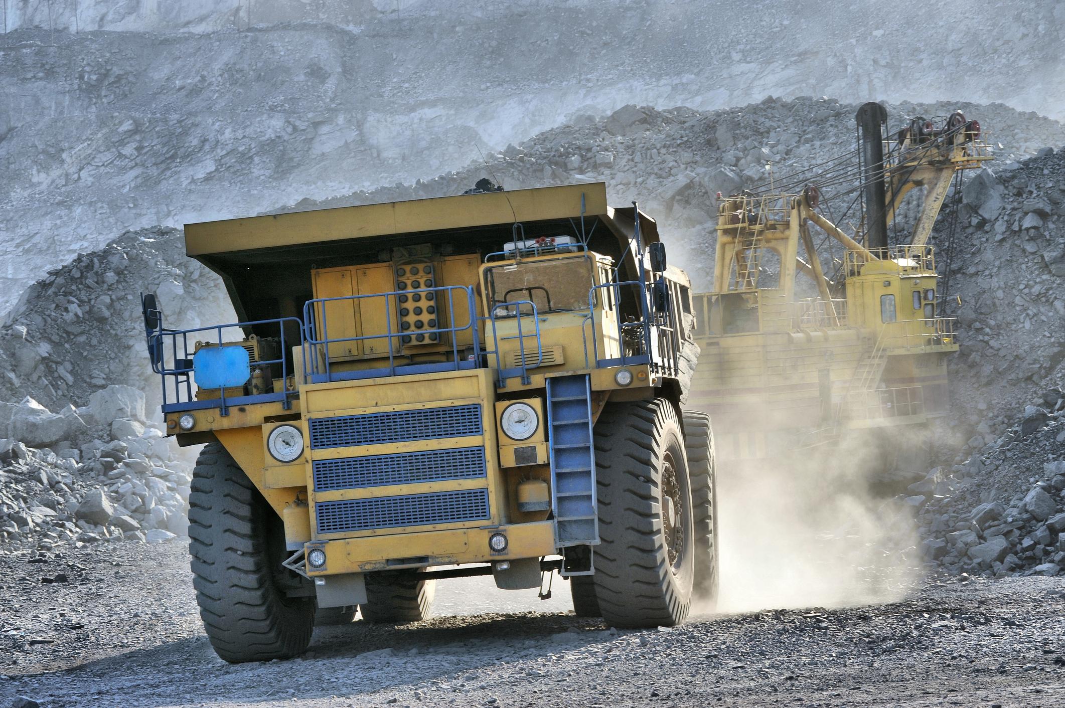 Mining truck getting loaded in open pit mine