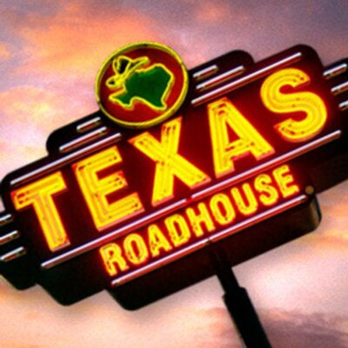 A neon Texas Roadhouse sign.