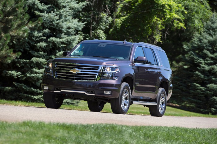 A Chevrolet Tahoe on a leafy street