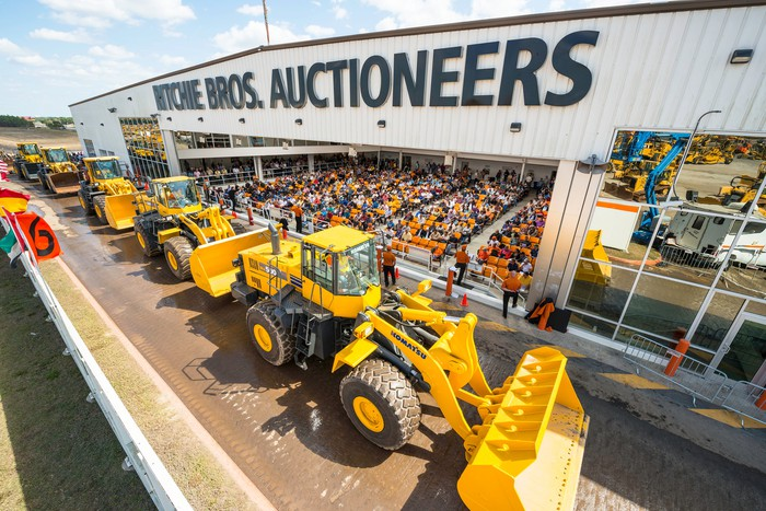 Row of heavy equipment at a Ritchie Bros. auction.