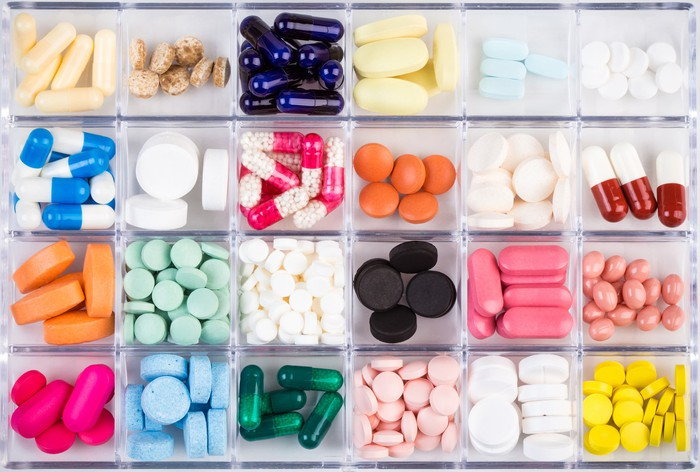 Divided container of many multicolored pills