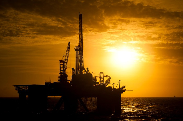 Offshore drill rig in silhouette