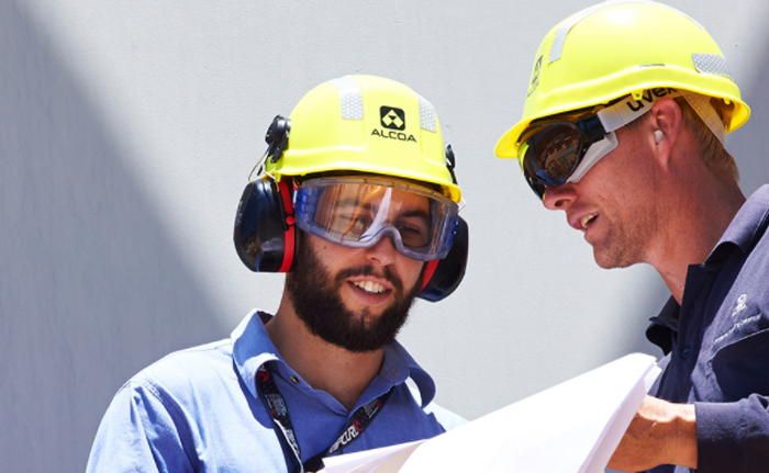 Two male Alcoa employees working together