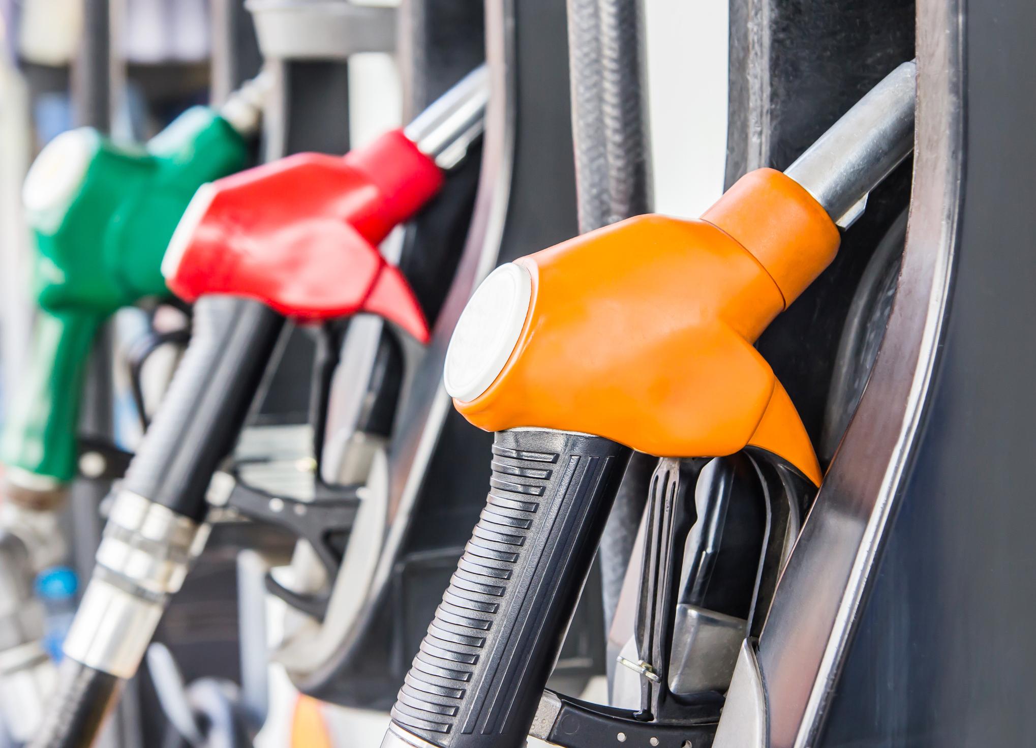 Gas station pumps up close.
