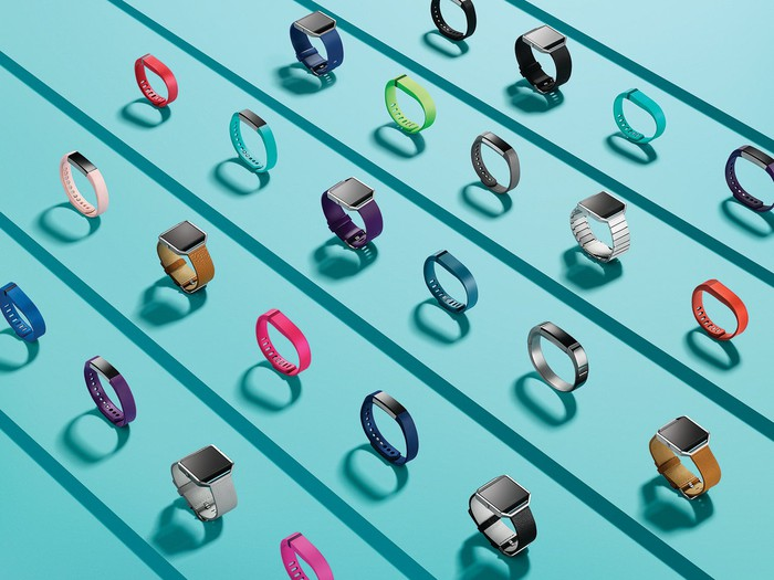 All of Fitbit's current products displayed in various colors.