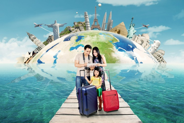 A family preparing for travel against the backdrop of major world sights.