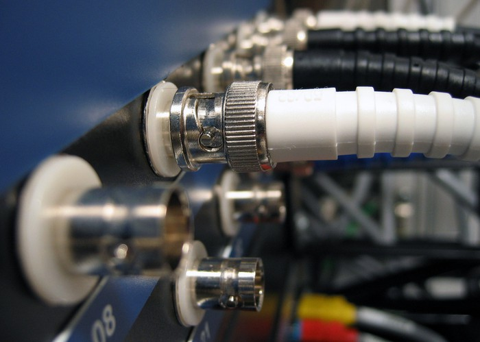 Coaxial cables plugged into networking equipment.