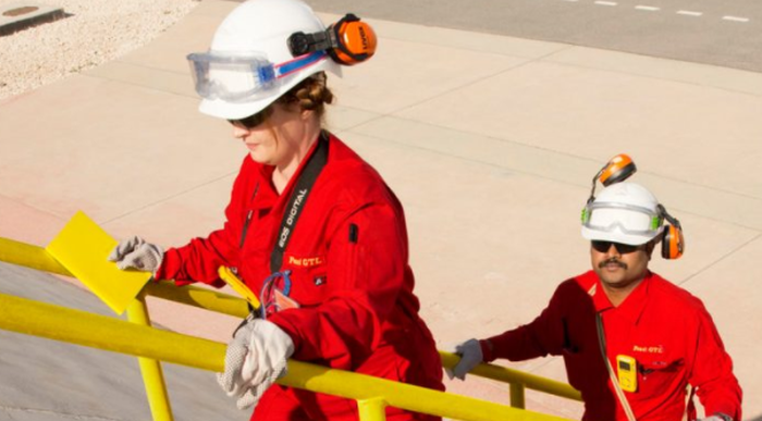 An image of Royal Dutch Shell employees walking up metal steps.
