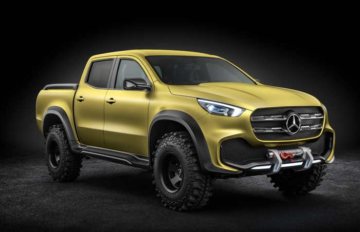 A yellow Mercedes-Benz X-Class pickup with off-road equipment visible.