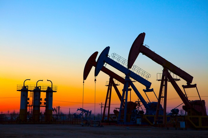 Oil pumping unit at sunset