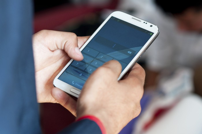 A man using a smartphone.