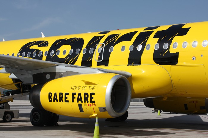 The wing and engine of a Spirit Airlines plane.