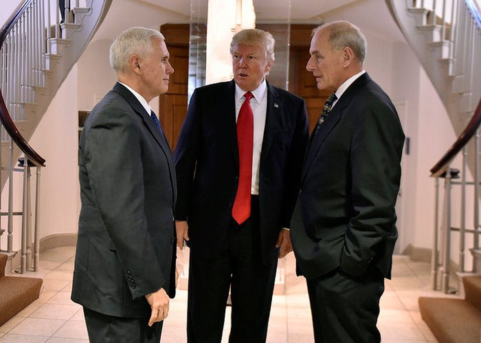 President Trump standing next to VP Mike Pence.