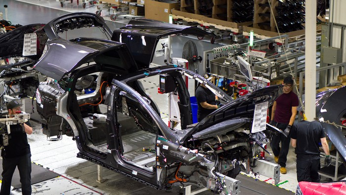 A partially assembled Model X moves down the assembly line at Tesla's Fremont, California factory.