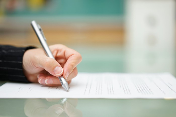 A person signing a loan document