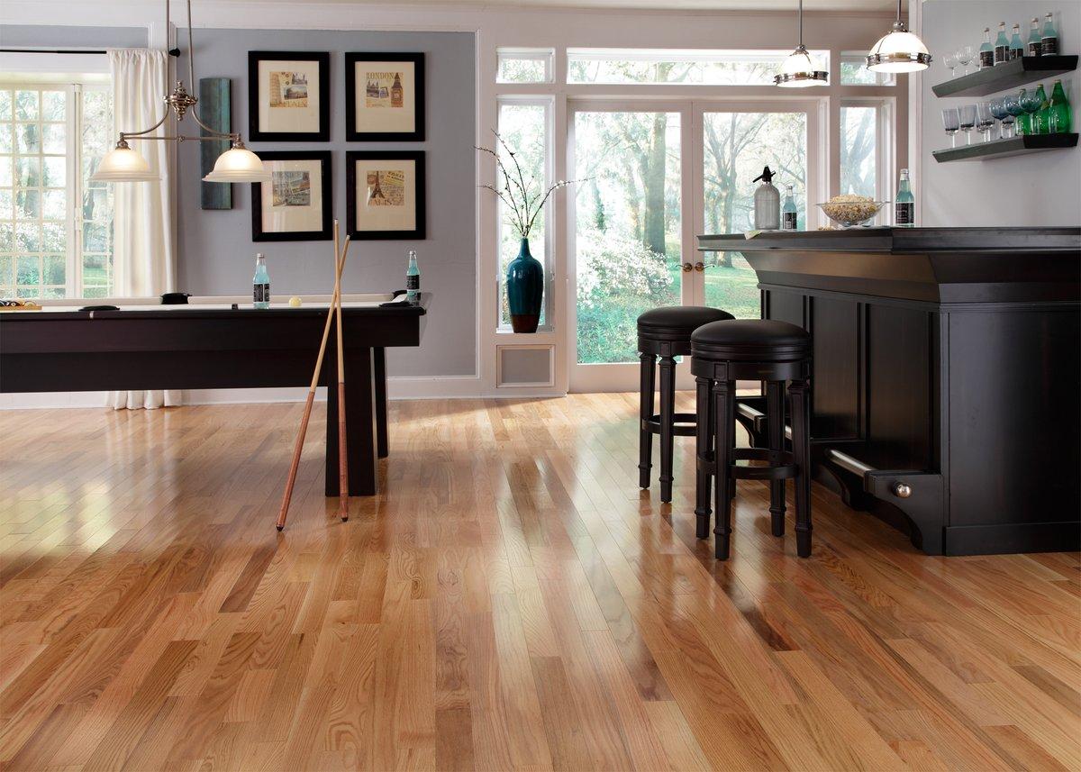 A billiard room in a house with Lumber Liquidators hardwood flooring.