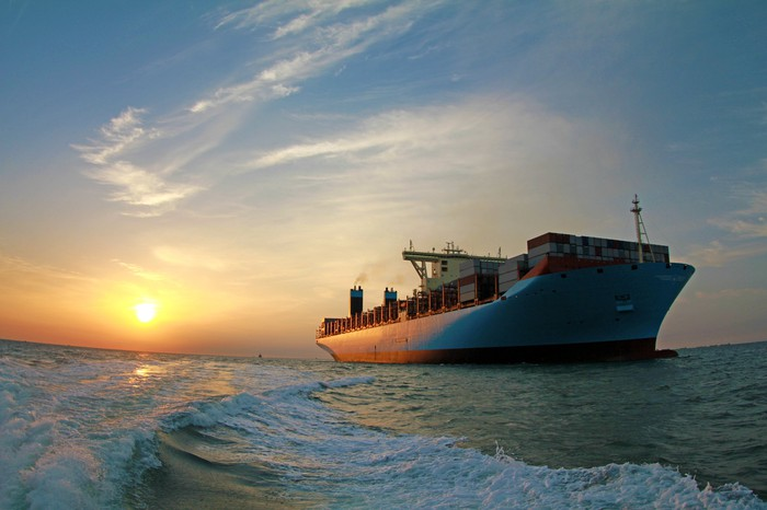 A container ship at sunset.