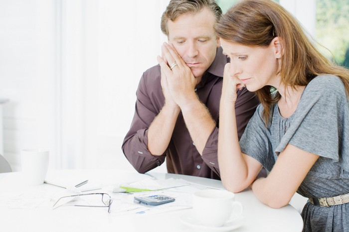 Couple looking over finances, worried