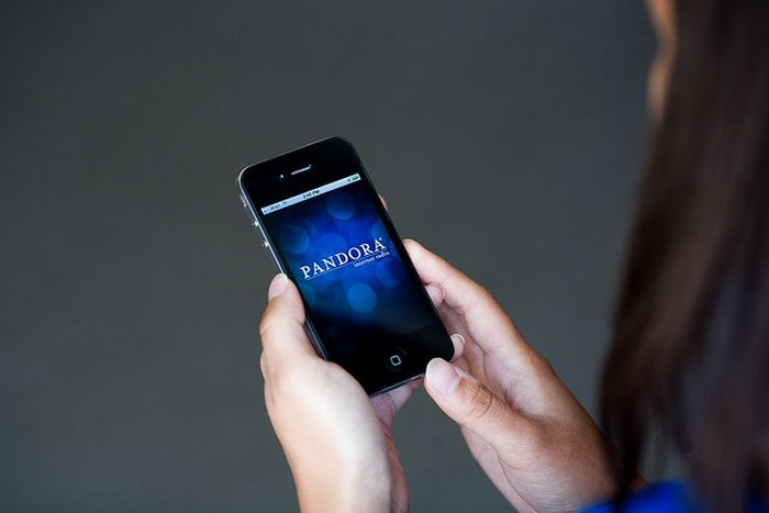 A person using the Pandora app on a smartphone