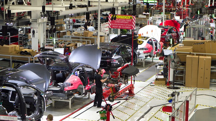 Partially assembled Model X SUVs on an assembly line in Tesla's Fremont, California, factory.