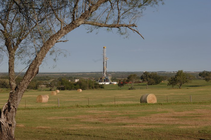 A drilling rig in a field.