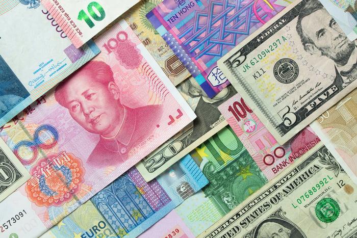 An array of money bills in various currencies - dollars, yen, etc.