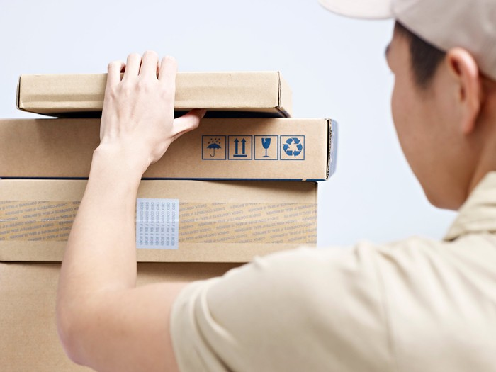 A worker grabs a package ready to be delivered.