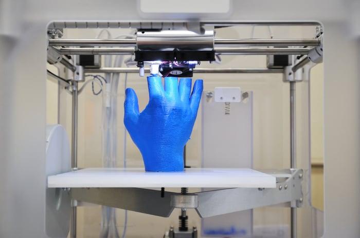 3D printing a blue hand.