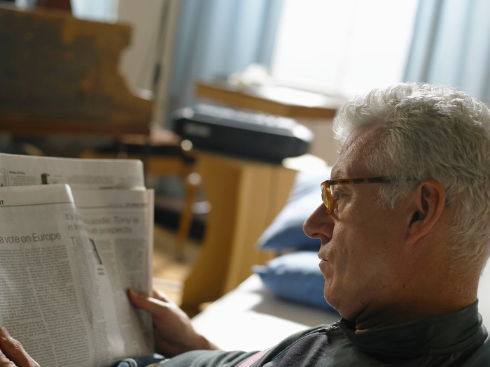 Older man reading the paper