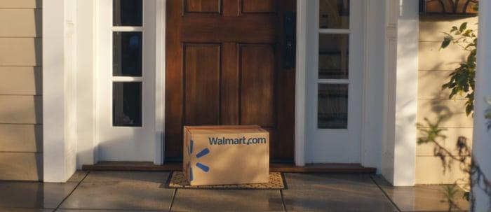 A Wal-Mart box sits on a doorstep.