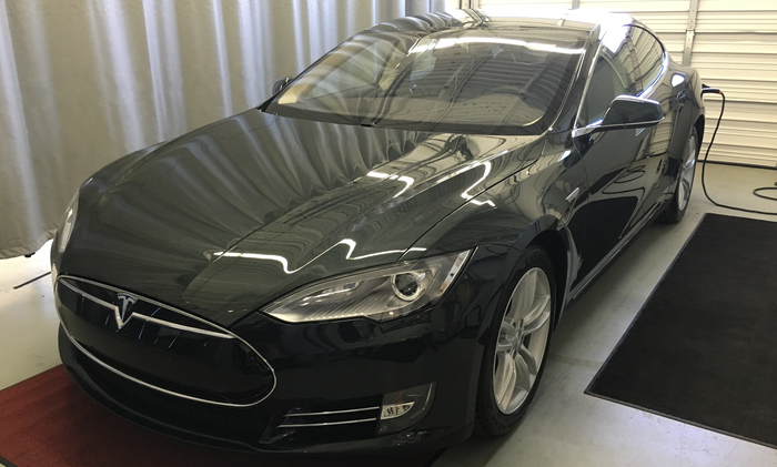Model S being delivered at a Tesla service center