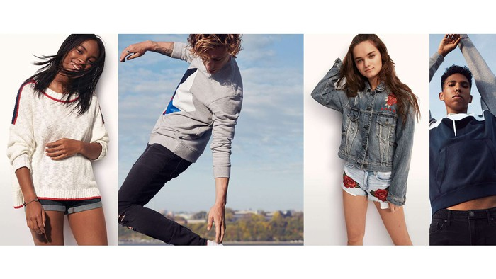 A group of young adults poses in American Eagle brand clothing.